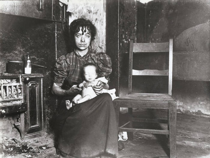 A Glasgow woman and baby in slum. c. 1910